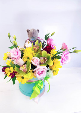 Presents flowers and teddy
