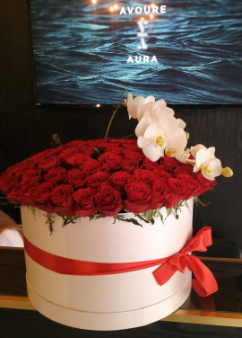 Orchids and roses  in a hat box