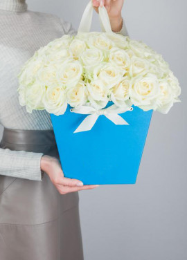 39 white roses in a bag-basket