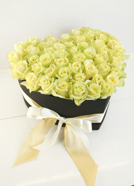 White roses in a heart box